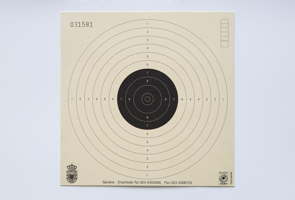 a buff-colored target with the first five circles black used as a metaphor for the evaluate your life day